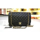 CHANEL Maxi Flap Bag In Caviar