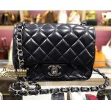 CHANEL Mini Flap Bag In Black Lambskin