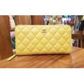 CHANEL Yellow Lambskin Zip Around Wallet