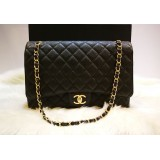 CHANEL Maxi Flap Bag In Caviar With GHW