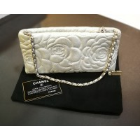 CHANEL Camellia Embossed Metallic Silver Pouch