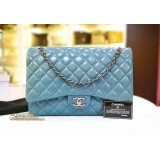 CHANEL Maxi Flap Bag In Quilted Lambskin